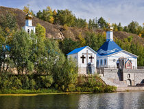 Orthodox Church on the shore of a pond Stock Images