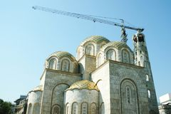 Orthodox church in Skopje, Macedonia under construction. Crane in background Royalty Free Stock Photography
