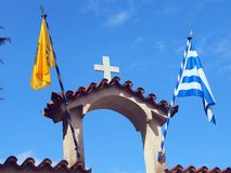 Orthodox Church Spire. Greek and yellow Orthodox Church flags flying on church spire, arch, Plaka,  Athens,  Greece Royalty Free Stock Image