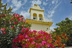 Orthodox church with spring flowers, Kefalonia, Greece Stock Image