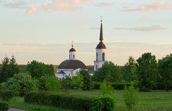 Orthodox church in the summer garden in the evening Royalty Free Stock Images