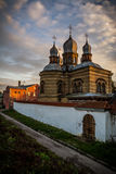Orthodox church at sunset in the city landscape. The monastery of the holy spirit of the Orthodox church of Latvia is seen in the ciy landscape. Beautiful sky at Stock Photos