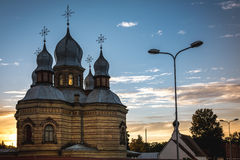 Orthodox church at sunset in the city landscape. The monastery of the holy spirit of the Orthodox church of Latvia is seen in the city landscape. Nearby are Stock Image