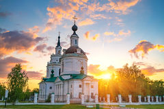 Orthodox church at sunset. Clouds over Russian orthodox church at sunset. Bolshoe Boldino, Russia Royalty Free Stock Photo