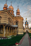 Orthodox church at sunset and path to it. Stock Photo