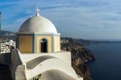 Orthodox church in town of Firostefani and panorama Santorini island, Thira, Greece Royalty Free Stock Image