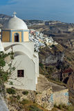 Orthodox church in town of Firostefani and panoramic view of Santorini island, Thira, Greece Stock Photo