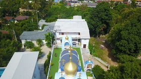 Orthodox church on tropical island, aerial view. Shot with a DJI Mavic fps29,97 FHD stock footage