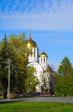 Orthodox church among turning yellow trees Stock Photography