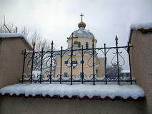 Orthodox Church in Ukraine. Orthodox church behind the fence Royalty Free Stock Image