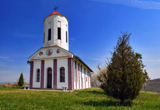 Orthodox Church. In the village of shaving near Leskovac is located on a wide green plateau church portals've painted in white with a bright red tower bell royalty free stock image