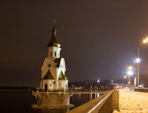 The orthodox church on the water at night Royalty Free Stock Photos
