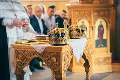 Orthodox church wedding ceremony. Gold Stock Photos