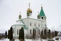 Orthodox church white walls green roof gold domes Christianity stock photography