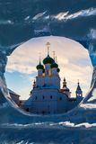 Orthodox church in a window of ice stock photography