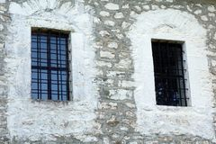 Orthodox Church Windows. Bared windows on a small stone built Greek Orthodox church, Greece royalty free stock photography