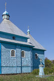 Orthodox Church. Wood Orthodox Church against background of blue sky and old cemetery Royalty Free Stock Photos