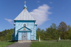 Orthodox Church. Wood Orthodox Church against background of blue sky and old cemetery Royalty Free Stock Images