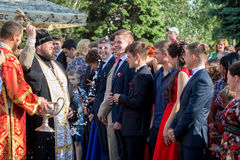 Orthodox consecration of pupils leaving school. 05.28.2016 House of Culture Kamenka-Dnepr, Zaporozhye region, Ukraine Orthodox consecration of pupils leaving Stock Photography