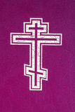 Orthodox cross. The orthodox cross printed on a cover of the bible (focus in a greater degree on the top part of a cross - a crucifixion Royalty Free Stock Photo