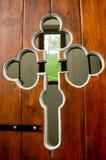 Orthodox cross as ornament on church door. Detail of orthodox cross as ornament on church wooden door Stock Photo