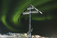 Orthodox cross on a background of the polar lights on the top of the mountain Royalty Free Stock Photo