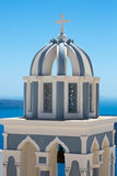 Orthodox Cross on the beautiful Blue and white rooftops Royalty Free Stock Photography