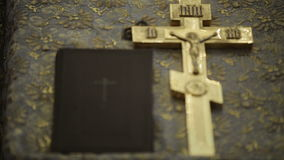 Orthodox cross with bible in church stock video footage