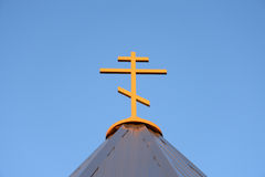 Orthodox cross on blue sky. Stock Photo