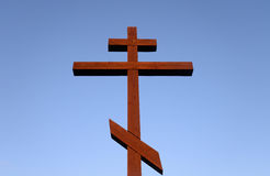 Orthodox cross on blue sky. Royalty Free Stock Photo