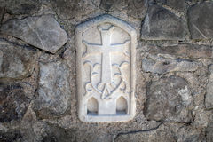 Orthodox cross carved on the wall of the church Stock Photos