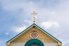 Orthodox cross at church rooftop against blue sky Royalty Free Stock Image