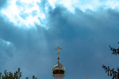 Orthodox cross at church rooftop against blue sky Royalty Free Stock Images