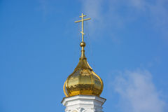 Orthodox cross at church rooftop against blue sky Royalty Free Stock Photos