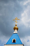 Orthodox cross at church rooftop against blue sky Royalty Free Stock Photo