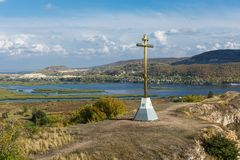 Orthodox cross on a hill. Orthodox cross on top of a hill Royalty Free Stock Image