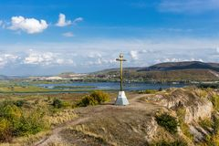 Orthodox cross on a hill. Orthodox cross on top of a hill Stock Photo