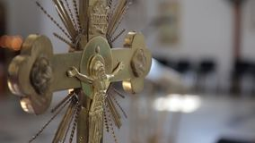 Orthodox cross with Jesus Christ crucifixion in church stock video