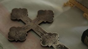 The Orthodox cross lies on the altar.  stock video footage