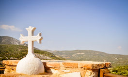 Orthodox cross and Mediterranean landscape Royalty Free Stock Photo