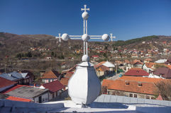 Orthodox cross over a village Stock Images