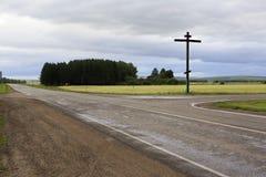 Orthodox cross on the road 1R-368 Stock Photo