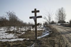 Orthodox cross on the side of a road in winter stock images