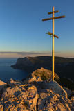 Orthodox cross at sunrise on top of mountain Ilyas Kaya. Royalty Free Stock Photo