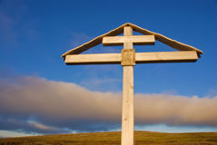 Orthodox cross at sunset over the Arctic Ocean Stock Photography
