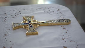 Orthodox cross. On the table, on a white tablecloth stock footage
