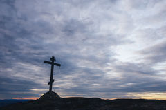 Orthodox Cross at the Top of the Hill. With Moving Clouds on Background located in Kandalaksha Russia Cola Penensula Region Stock Photo