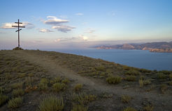 Orthodox cross on top of a mountain overlooking the sea. Crimea. Stock Photography