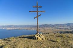 Orthodox cross on top of a mountain overlooking the sea. Crimea. Stock Photo