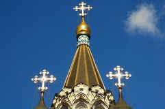 Orthodox crosses on a gold dome on a blue sky background on the Church of the Resurrection in Sokolniki, Moscow, Russia. Close-up. Horizontal view Royalty Free Stock Image